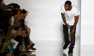 Kanye West acknowledges applause at the end of his Spring/Summer 2012 show at Paris Fashion Week