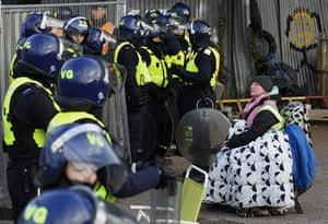 Dale Farm: a campaigner in front of a cordon of riot police