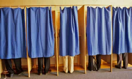 Voters cast their vote.