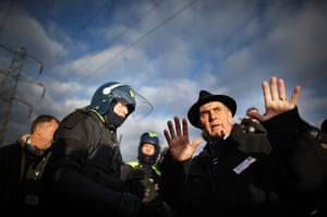 Dale Farm evictions: Grattan Puxon from The Gypsy Council negotiates with a policeman
