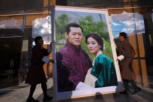 From the agencies: Workers carry a portrait of the King and future Queen of Bhutan