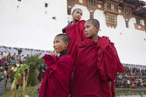 From the agencies: Monks watch the Bhutan royal wedding