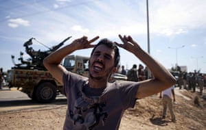 Libya celebrates: A Libyan rebel fighters reacts in Sirte