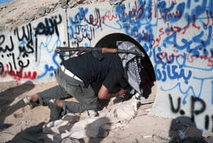 Libya celebrates: Libyan fighter inspects the tunnels where Muammar Gaddafi was found, Sirte