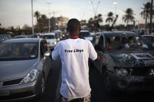 "Libya celebrates: A Libyan man wearing a tshirt bearing the slogan ""Free Libya"" , Tripoli"