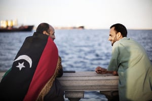 Libya celebrates: A Libyan man wears a national flag during celebrations, Tripoli