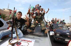 Libya celebrates: Libyans celebrate the fall of Sirte and death of Muammar Gaddafi in Tripoli