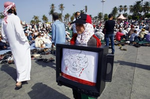 Libya celebrates: girl carries a TV