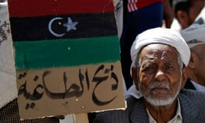 Yemeni protester with Libyan flag