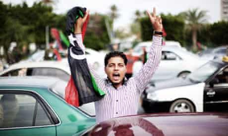 Libyan youth celebrates after Muammar Gaddafi's death