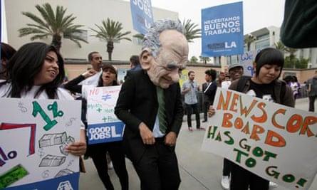 Protester dressed as Rupert Murdoch
