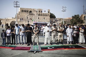 Libya after Gaddafi: Libyans perform the Friday noon prayer outdoors in Tripoli's Martyrs Square