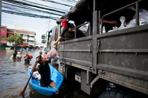 Thailand floods : A Thai resident receives food relief on in Pathum Thani