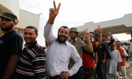 Libyans queue