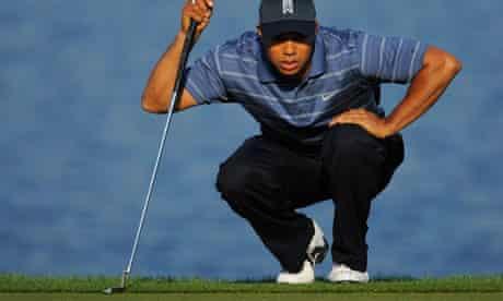 Tiger Woods lines up a putt
