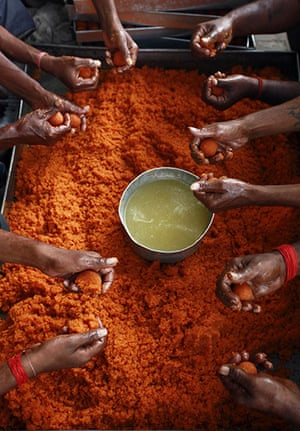 24 hours in pictures: Laddu, a traditional sweet, is prepared at the Hanuman Temple in Allahabad