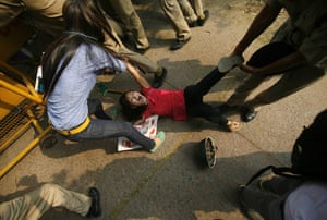 24 hours in pictures: A Tibetan exile is detained by police  in New Delhi