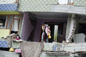 Turkey earthquake: An earthquake survivor collects belongings from a collapsed building, Ercis