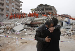 Turkey earthquake: Two men comfort each other near a collapsed building in Ercis