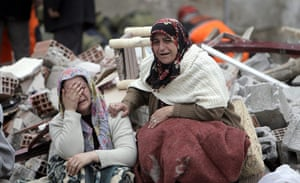 Turkey earthquake: Relatives of victims mourn in front of a collapsed building in Ercis
