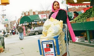 Indian woman with a supermarket trolley in a New York street