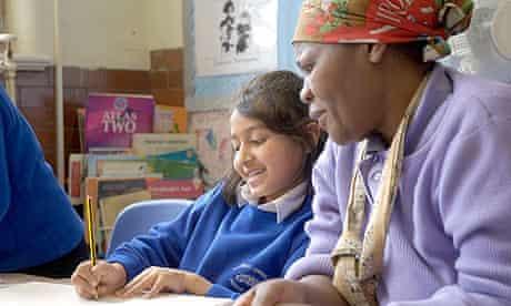 Volunteer helping primary school student
