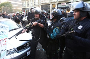 occupy oakland clashes: Police officers with firearms confront protestors