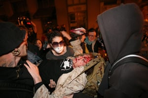 occupy oakland clashes: a man who was hit by a tear gas canister shot by the Police