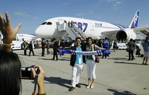 Dreamliner first flight: A couple pose for a souvenir photo before boarding