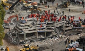 Turkish earthquake rescue teams work at a collapsed building in Ercis