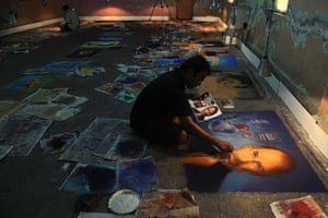 Diwali festival of lights: An Indian artist makes finishing touches to a rangoli depicting Steve Jobs