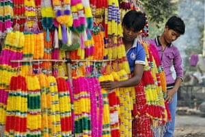 Diwali festival of lights: Indian street vendors sell artificial garlands in Allahabad, India