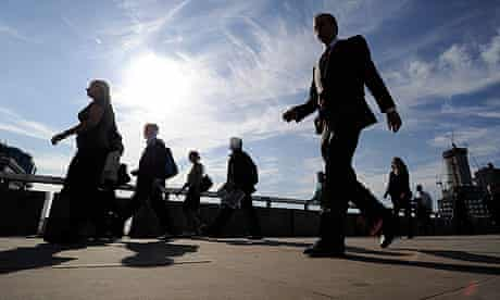 City workers cross London Bridge during the morning rush-hour