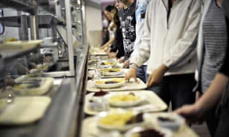 French students collect meals in their school canteen