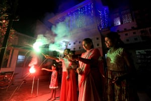 Diwali festival of light: Indian women enjoy sparklers during Diwali festival in Calcutta, India