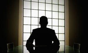 Silhouette of man in boardroom