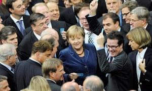 Angela Merkel takes part in the vote at the Bundestag