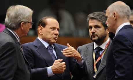 Silvio Berlusconi talks with Jean-Claude Juncker and George Papandreou