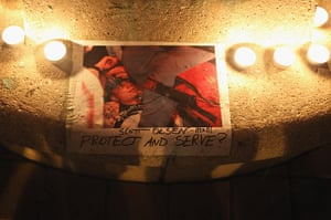 Occcupy Oakland: A picture of Scott Olsen is surrounded by candles