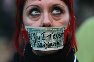 Occcupy Oakland: Valerie Sowers protests with a dollar bill taped over her mouth