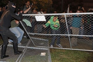 Occcupy Oakland: Protesters take down the fence surrounding Frank H Ogawa Plaza
