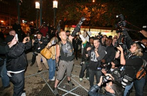 Occcupy Oakland: An Occupy Oakland protester poses in front of the media