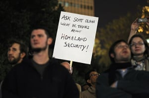 Occcupy Oakland: A protester holds up a sign referencing Scott Olsen