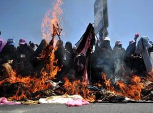 24 hours in pictures: Sana'a, Yemen: Women burn veils