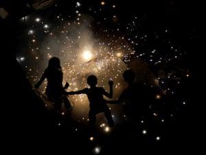 24 hours in pictures: New Delhi, India: Children light fireworks for Diwali