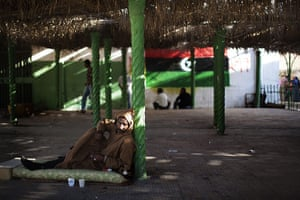 24 hours in pictures: Tripoli, Libya: A man relaxes on a mattress outside a mosque