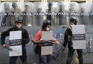 24 hours in pictures: Bogota, Colombia: Students mock riot police during a demonstration