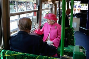 24 hours in pictures: Melbourne, Australia: The Queen and the Duke of Edinburgh ride on a tram