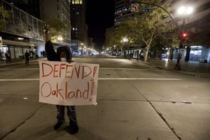 Occupy Oakland protest: A lone protester stands in the middle of 14th and Broadway