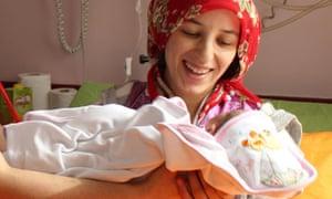Semiha Karaduman holds her baby girl Azra